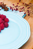 Raspberry on blue plate Royalty Free Stock Images