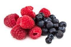 Raspberry and blueberries isolated on white background.  Stock Image