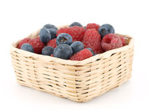 Raspberry and a blueberry Royalty Free Stock Photos