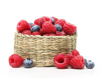 Raspberry and blueberry in basket Royalty Free Stock Photography