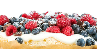 Raspberry and blueberry cake. Closeup of raspberry and blueberry cake toppings Royalty Free Stock Image