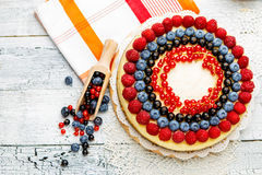Raspberry and blueberry cheesecake on wooden table Stock Photography
