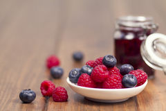 Raspberry and blueberry jam Stock Photography