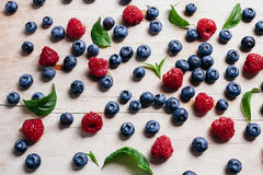 Raspberry and blueberry juicy with green mint leaves vitamin col Stock Photo