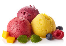 Raspberry, blueberry and mango sorbet. Raspberry, blueberry and mango ice cream sorbet balls isolated on white background Stock Photography