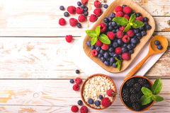Raspberry, blueberry with mint and oatmeal breakfast or smoothie Stock Image