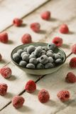 Raspberry with blueberry. Mix of fresh berries on rustic wooden background. Berries on Wooden Background. Summer or Spring Organic Berry over Wood Royalty Free Stock Photo