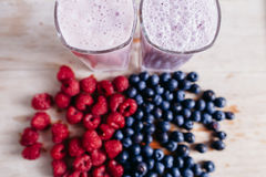 Raspberry and blueberry smoothie with fresh berries on wood tabl Stock Photo