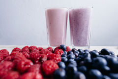 Raspberry and blueberry smoothie with fresh berries on wood tabl Royalty Free Stock Photography