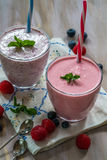 Raspberry and blueberry smoothie with yogurt. Garnished with fresh mint Stock Image