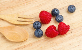 Raspberry and blueberry on wood background, Fresh fruit, Stock Images