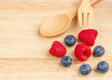 Raspberry and blueberry on wood background, Fresh fruit. Raspberry and blueberry on wood background, Fresh fruit, Spoon fork Royalty Free Stock Image