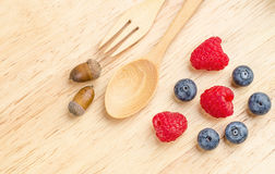 Raspberry and blueberry on wood background, Fresh fruit. Spoon fork Stock Image