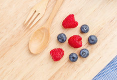 Raspberry and blueberry on wood background, Fresh fruit, Stock Photography