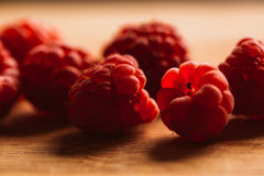 Raspberry on a blurred background of wooden planks Royalty Free Stock Photography