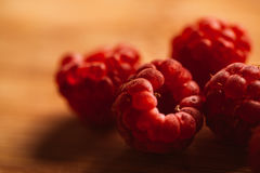 Raspberry on a blurred background of wooden planks Stock Images