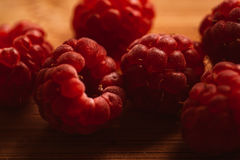 Raspberry on a blurred background of wooden planks.  Royalty Free Stock Photography