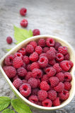Raspberry in bowl in the form of heart Royalty Free Stock Photos