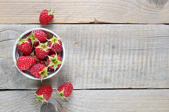Raspberry in bowl on old wooden table Royalty Free Stock Photography