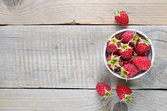 Raspberry in bowl on table. Raspberry in bowl on wooden table Stock Photos
