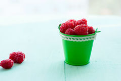 Raspberry in a bucket. Fresh ripe raspberry in small bucket Stock Images