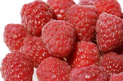 Raspberry bunch. A group of raspberries close up, showing their seeds and hairy skin stock photography