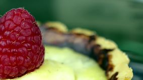 Raspberry on cake close up stock video footage