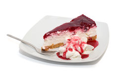 Raspberry cake with and cream and topping isolated Stock Photography