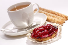 Raspberry cake with a cup of tea and biscuits. Raspberry cake with a cup of tea and sesame biscuits Stock Photo