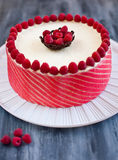 Raspberry cake with fresh berries. Close up of raspberry cake over white plate Royalty Free Stock Image