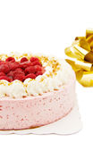 Raspberry cake with golden ribbon. Celebrating a special day with raspberry cake and festive golden ribbon. Isolated over white stock photo
