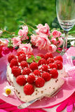 Raspberry cake in heart shape Royalty Free Stock Photo