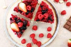 Raspberry cake and many fresh raspberries. Fresh spring cream cake with blackberries, blueberries and raspberries Royalty Free Stock Photography