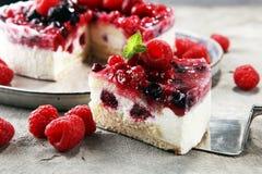 Raspberry cake and many fresh raspberries. Fresh spring cream cake with blackberries, blueberries and raspberries Stock Photo
