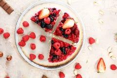 Raspberry cake and many fresh raspberries. Fresh spring cream cake with blackberries, blueberries and raspberries Stock Images