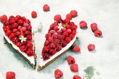 Raspberry cake and many fresh raspberries. Fresh spring cream cake with blackberries, blueberries and raspberries Stock Photos