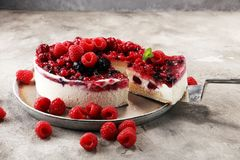 Raspberry cake and many fresh raspberries Royalty Free Stock Image