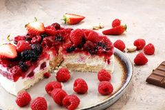 Raspberry cake and many fresh raspberries. Fresh spring cream cake with blackberries, blueberries and raspberries Stock Photography