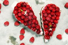 Raspberry cake and many fresh raspberries. Fresh spring cream cake with blackberries, blueberries and raspberries Stock Image