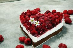 Raspberry cake and many fresh raspberries. Fresh spring cream cake with blackberries, blueberries and raspberries Royalty Free Stock Images