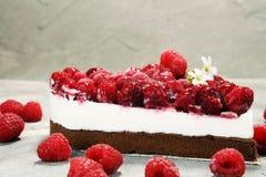 Raspberry cake and many fresh raspberries. Fresh spring cream cake with blackberries, blueberries and raspberries Royalty Free Stock Image