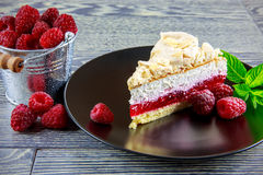 Raspberry cake. With meringue top arranged on a wooden table Stock Photography