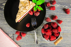 Raspberry cake. With meringue top arranged on a wooden table Stock Photo
