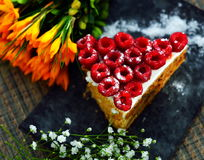 Raspberry Cake. On plate and beautiful flowers Stock Image