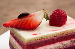 Raspberry cake in a plate on wooden table stock photo