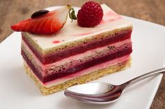 Raspberry cake in a plate on wooden table royalty free stock photo