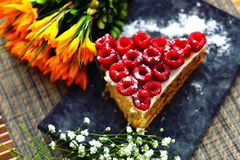 Raspberry Cake on plate. And yellow flowers Stock Images