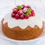Raspberry cake with sugar icing. On a white background, square image Royalty Free Stock Photo