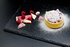 Raspberry cake tart with cream, almond and chocolate stock photography