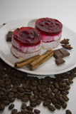 Raspberry cakes with coffee beans background Stock Photo
